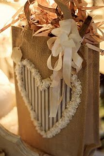 Burlap Bags With Coordinating Fabric Tie, Glittered Monogram Letter And A Sprig Of Greenery For A Natural Gift Packaging Look