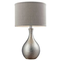 An artful touch for your living room or master suite, this stylish table lamp showcases a textured chrome-finished base and timeless grey shade.