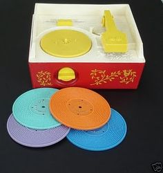 My first record player ever! Played those little records with dots on them- just wind it up and it would play tune.