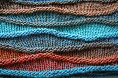 Wavy Cowl made from Rowan Colourscape Chunky in the Camouflage colourway. Pattern can be found here: http://www.knotions.com/issues/winter_2008/patterns/wave/directions.aspx