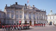 Amalienborg Palace is where the Danish Royal Family lives. The changing of the guard outside Amelienborg palace happens at noon daily, and is something I would love to see.