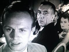 "Richard Widmark and Mike Mazurki in the 1950 film ""Night and the City."""