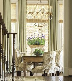 Dramatic window treatments -- woven wood shades and full-length draperies.  We can help you achieve this look.  www.budgetblinds.com/southorlando