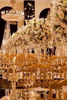 Elegant & Extravagant wedding reception setup with tall centerpieces and long tables. Gold, blush and pink.