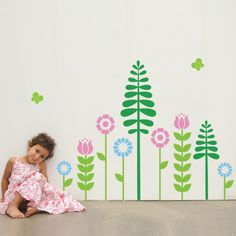 Make your kids' fantasies come true with these Flowers garden wall stickers. Simply peel and stick the colorful kids' wall decal to transform your nursery into a private indoor garden. Removable vinyl wall stickers are the perfect wall decor solution.$62.95