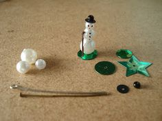 Madame Petite: Miniature snowman. Could make a loop at the top of the hat with a headpin and hang as a tree ornament!