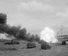 THE BRITISH ARMY IN THE NORMANDY CAMPAIGN 1944. An ammunition lorry of 11th Armoured Division explodes after being hit by mortar fire during Operation 'Epsom'