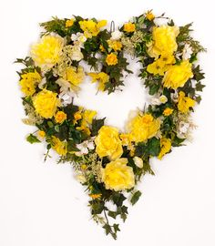 This large heart wreath is perfect for a front door, over a mantel. Yellow Roses, green ivy, dogwood, astilbe all created on an all natural grapevine base. At wide it makes a bold statement. Wreath Crafts, Diy Wreath, Grapevine Wreath, Fall Wreaths, Mesh Wreaths, Valentine Day Wreaths, Valentines, Sympathy Flowers, Heart Wreath