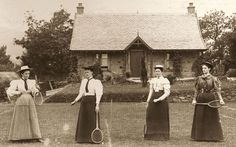 Four Victorian ladies ready for a game in 1888