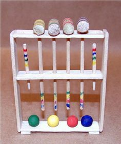 Croquet set DIY - balls are plain wooden beads filled with wood filler then painted