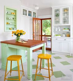 Color is, by its nature, idiosyncratic: What works for one person might not work at all for another. Some people favor bold tones, while others swing lighter and brighter. If you have a particular bold kitchen color you'd like to use, be mindful of how it might look when used in a whole room. If you're worried, choose key focal points -- here, a built-in bookcase and peninsula table -- as options to display your favorite hue./