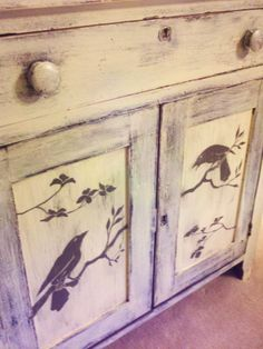 Antique 1800's One Drawer Walnut Cabinet. Original Brass key hole plate. Original Knobs, Square nailed. Ben, at our shop, has hand painted the birds and branches on the front of this piece and it has been painted a lovely fresh mellow white with distressing. For more photos and info. see our shop.  Price:  275.00