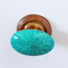 Prettying up drawer knobs on the cheap with a sharpie and baking in the oven for the look of Malachite. DIY on the sly!