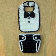 This adorable set for your 'Little Man' is very cute.    The Bib is in white and edged in black, with black bowtie and 2 black buttons. The co-ordinating Nappy / Diaper cover is in black with white edging and white buttons to fasten. This set is so cut...