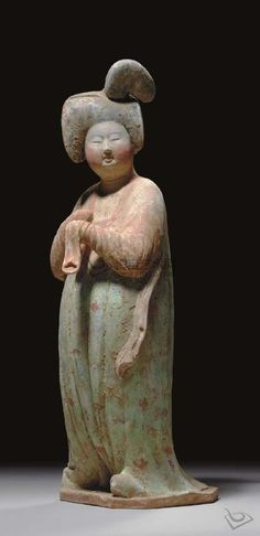 TANG DYNASTY (618-907) A PAINTED POTTERY FIGURE OF A COURT LADY