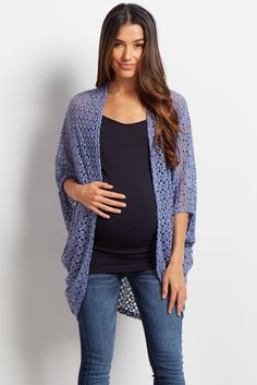 This is the perfect maternity cardigan for all day comfort and style. An oversized fit with short dolman style sleeves gives you a chic slouchy look that makes it easy to layer over a cami and a pair of maternity jeans. You can wear this maternity cardigan with a statement necklace and booties.