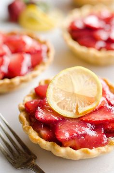 Mini Strawberry Lemon Pies are the perfect dessert recipe to serve your party guests for an individual sweet they will love! A flaky pie crust is topped with a lemon cream cheese layer, fresh strawberries and a sweet strawberr sauce for tons of great flavor and texture! #Mini #Dessert #Strawberry #Pie