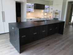 View our photo gallery to see soapstone installations we have done across Canada. We've installed soapstone countertops, tiles, sinks, fireplaces and more. Soapstone Kitchen, Soapstone Countertops, Kitchen Countertops, Kitchen Island, Waterfall Island, Kitchen Design, Kitchen Ideas, New Homes, Flooring