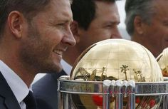 The Sydney Harbour Bridge is reflected in one of several Cricket World Cup trophies as Australian cricket team captain Michael Clarke gathers with former Australian World Cup-winning captains during an event marking the 100-day countdown to the 2015 Cricket World Cup in Sydney November 6, 2014. REUTERS/Jason Reed/Files