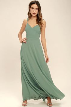 Your allure will be at an all-time high when you slip into the Meteoric Rise Sage Green Maxi Dress! Breezy woven fabric sweeps over a princess seamed, triangle bodice with ruffled, adjustable straps. An open back and covered buttons adds an elegant touch, while a full maxi skirt sways below.
