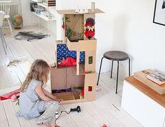 DIY: 6 Ways To Make A Cardboard Dollhouse. via Handmade Charlotte Cardboard Box Houses, Cardboard Dollhouse, Cardboard Toys, Diy For Kids, Crafts For Kids, Dollhouse Furniture, Barbie Furniture, Imaginative Play, Kid Spaces