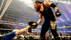 WWE.com: Unseen Undertaker: photos  http://us.wwe.com/inside/raw1000/unseen-undertaker-photos#  BTW  that devil on his gear is really awesome