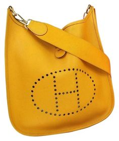 Herms Evelyne Gm Couchevel Leather Yellow Cross Body Bag. Get the trendiest Cross Body Bag of the season! The Herms Evelyne Gm Couchevel Leather Yellow Cross Body Bag is a top 10 member favorite on Tradesy. Save on yours before they are sold out!