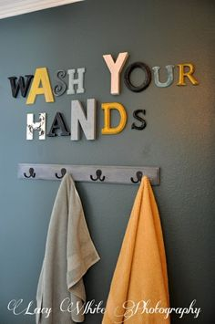 It would be great to get rid of the towel bar so that Justin could hang up his own towel! Love the letters, but too many nails in the wall. Do in a picture frame with paper letters....much cheaper too.