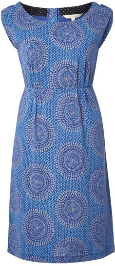 It looks like dots, but this is a tile design print dress - read about this cool summer trend - http://www.boomerinas.com/2015/05/14/moroccan-tile-print-maxi-dresses-tunics-for-women-over-40-50-60/