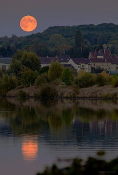 The Full Moon rises above Saarlouis and the Saar river in Germany.