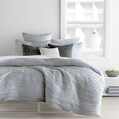 DKNY City Pleat Grey Duvet Cover, King  Available Colors: Grey Available Sizes: Engage your space with the pared-down elegance of DKNY's City Pleat duvet cover in light grey. Horizontal pleats dance across the front, creating a sense of soothing movement and warm allure in your bedroom.