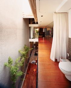 this house is sweet, long narrow open but yet sheltered. Its in singapore