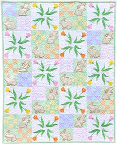 Stop and Smell the Tulips Quilt Pattern. This is a great quilt to get you in the mood for spring and summer! Appliqué tulips form a fun pinwheel design, while the appliqué bunnies look like they're just about ready to start nibbling! Includes CD http://www.kayewood.com/item/Stop_and_Smell_the_Tulips/2579/m120 $16.95