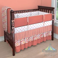 Crib bedding in Solid Coral, Coral Watercolor Herringbone, Solid Peach, Solid Light Coral, Coral Stars. Created using the Nursery Designer® by Carousel Designs where you mix and match from hundreds of fabrics to create your own unique baby bedding. #carouseldesigns