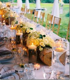 this is for a wedding but how cool to cut holes in a long thin log and put flowers or candles in them at home - from Gwen Moss