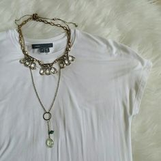 """Vince white tee Soft and drapey, classic white tee. Worn once, perfect condition with no flaws I can see! 95%micromodal with 5%spandex. Great with jeans and some fun necklaces, or even to work under a cardigan or blazer. About 25"""" long. Vince Tops Tees - Short Sleeve"""