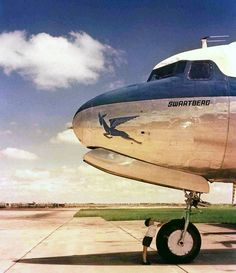 A young lad stands in awe of the landing gear of a SAA, Douglas Skymaster named 'Swartberg' -- circa 1958 Africa Symbol, Douglas Dc 4, Nostalgic Pictures, Douglas Aircraft, Aircraft Painting, Walk The Earth, Landing Gear, Paint Schemes, Best Photographers