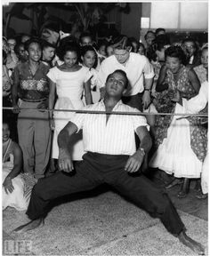 The extraordinary reluctant King of Calypso, Harry Belafonte doing the limbo (a. the under stick dance). It originated in Trinidad. The object was to have 2 people lower a stick and see how low you could go under the stick w/o touching it. Shall We Dance, Lets Dance, Calypso Music, Gil Scott Heron, Harry Belafonte, Port Of Spain, The Dancer, Music Sing, My Escape