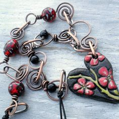 flowers heart pendant Beautifully Broken Me: More October Prima Beads Projects Ceramic Jewelry, Copper Jewelry, Polymer Clay Jewelry, Glass Jewelry, Wire Jewelry, Handmade Jewelry, Copper Wire, Jewlery, Beads And Wire