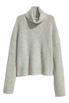 Wool polo-neck jumper: PREMIUM QUALITY. Rib-knit polo-neck jumper in soft wool. The jumper is in a wide style with dropped shoulders and long sleeves.
