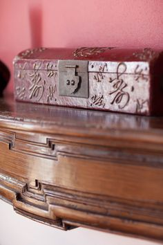East meets West at French Chateau. Antique Chinese box on classic French Fireplace. www.chateaurobertfrance.fr