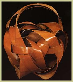 Flower-arranging basket, c. 1930-1940, woven by Ishikawa Shôun using wide, swirling slats of honey-colored bamboo, (from Kagedo Japanese Art) www.kagedo.com