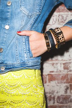 Middle bracelet (to right of Fuelband) -Pink rectangle jeweled bracelet: Holst   Lee, Coquette Colorblock bracelet, $175 via StyleList