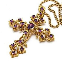 Cartier cross pendant and necklace crafted in solid 18 karat yellow gold and natural amethyst gemstones.