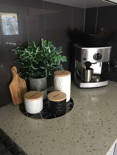 Minimalist coffee station with coffee machine and ceramic pots with wooden deck . - Minimalist coffee station with coffee machine and ceramic pots with wooden lids – Minimalist coff - Home Decor Kitchen, New Kitchen, Home Kitchens, Decorating Kitchen, Kitchen Counter Decorations, Kitchen Island, Coffee Bar Home, Home Coffee Stations, Coffee Station Kitchen