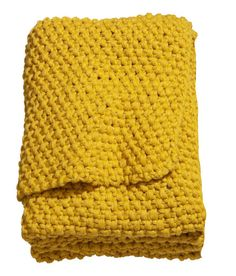 Mustard yellow miss-knit blanket from H&M.