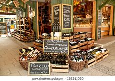 MUNICH-APRIL 4. A gourmet food and wine shop offers international specialties at Viktualien Markt open air market, famous landmark and touri...
