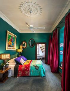 The wall color and the curtains are SO ME!  I love the feel of this room--although it's a little sparse for my liking. SR