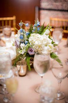 Stunning simple floral arrangement! #centerpiece #whiteflowers #blueflowers #purpleroses #floralarrangement #powerstationevents #inbloomfloral