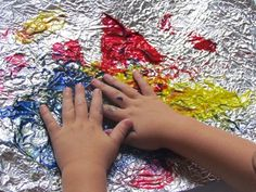 Exploring paint on an aluminium foil is very helpful for children in terms of sensory experience. Through experiencing its unique texture: smooth, flexible, and bumpy, children can also develop their motor skills and descriptive vocabulary. Sensory Art, Sensory Activities, Infant Activities, Preschool Activities, Teach Preschool, Toddler Art, Toddler Crafts, Classroom Fun, Fine Motor Skills